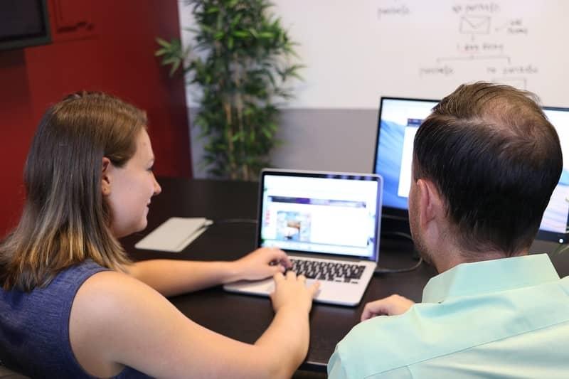 two team members working on website